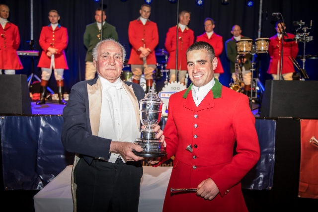 The 2018 Champion, Jake Oppenheim from the Cheshire, being presented with the Dorian Williams Horse & Hound Trophy by Capt. Ian Farquhar